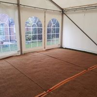 Frame and covers with coir matting on floor
